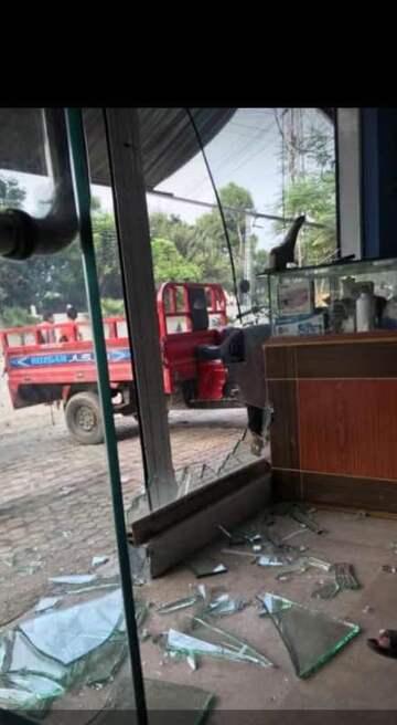 My uncle's shop's glass broken (public domain)