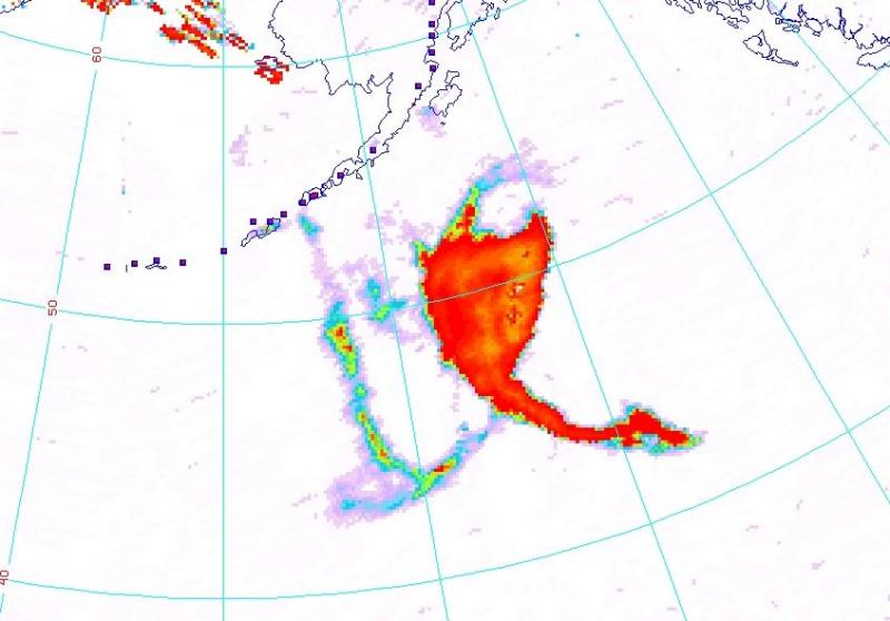 image showing the extent of the sulfur dioxide gas cloud from the eruption of Okmok Volcano. The large red mass is from the main explosive phase on 12 July at 2130 UTC and is at an estimated height of 50,000 ft above sea level. The north-south dimension of this cloud is about 850 miles. Current emissions from the volcano are at a lower altitude of approximately 30,000 to 35,000 feet. Other OMI data (not shown) indicate that volcanic ash is mixed with the sulfur dioxide cloud.