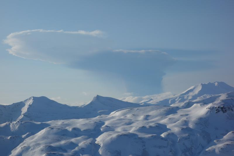 February 19 Bogoslof eruption plume as seen from Unalaska Island, 53 miles ESE of Bogoslof volcano. Photo taken from helicopter during fieldwork by AVO geologists at 5:22PM, approximately 14 minutes after the start of the eruption. (image: Janet Schaefer / AVO)