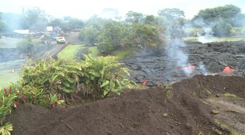 County of Hawaii media image of lava flow reaching earth barrier in Pahoa village on Oct 29, 2014.