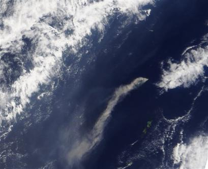 This image was released by NASA Tuesday April 5, 2005; it shows a thick cloud of ash erupted from the Anatahan Volcano, Mariana Islands (Pacific Ocean). According to the Washington Volcanic Ash Advisory Center, a series of low-level eruptions starting on April 4 have created this plume.