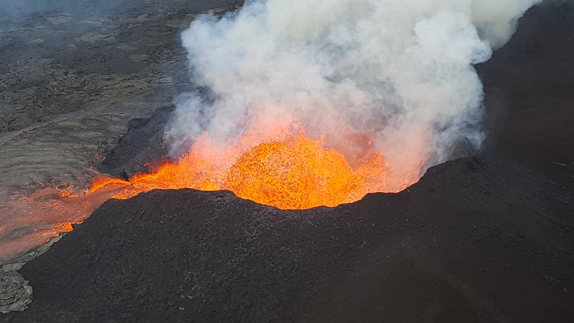 This photo take during a 17 June, 2018, morning overflight shows a fissure 8 lava fountain pulsing to heights of 50 m (165 ft) within the cinder spatter cone. (HVO/USGS)
