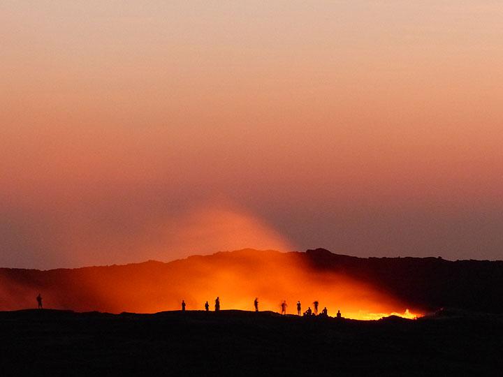 Observers at the edge of Erta Ale´s summit lava lake around dawn, November 2015 (photo: Ingrid Smet - VolcanoAdventures)