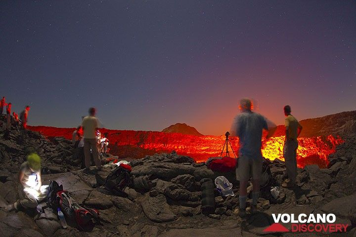 Nighttime observation of Erta Ale's active lava lake under the stars and red glow (Tom Pfeiffer)