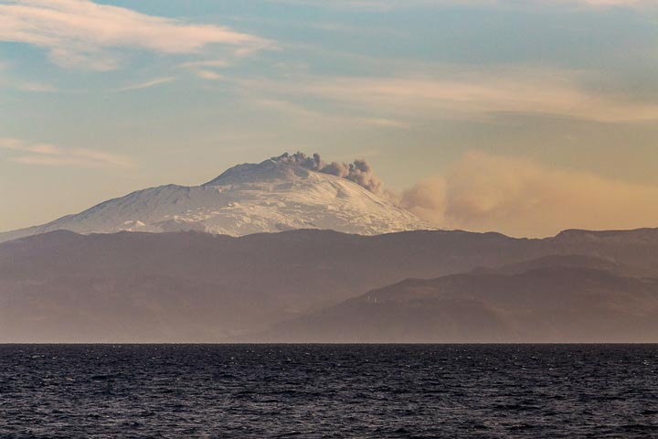 Etna erupting ash from NE crater as seen last evening from Lipari (!) during extremely clear weather (image: Emanuela Carone / VolcanoDiscovery Italia)