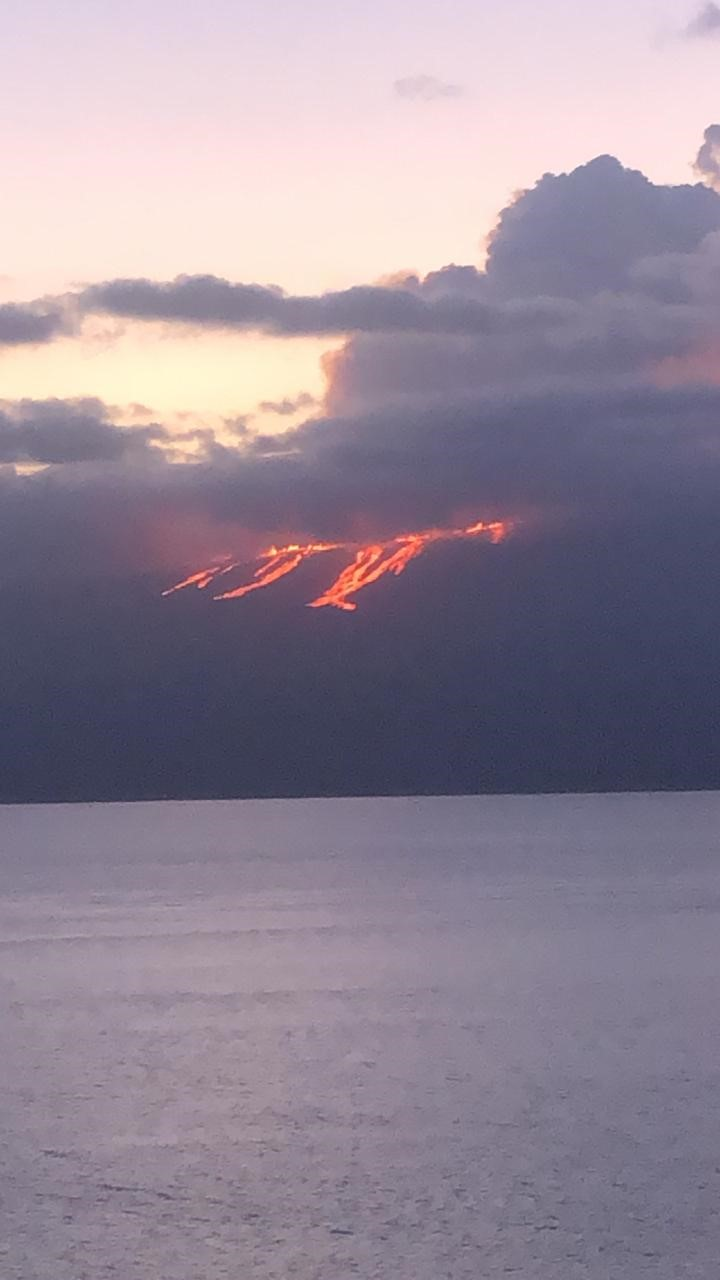 Lava flows as seen from the Bolivar Channel. Credit: Galapagos National Park