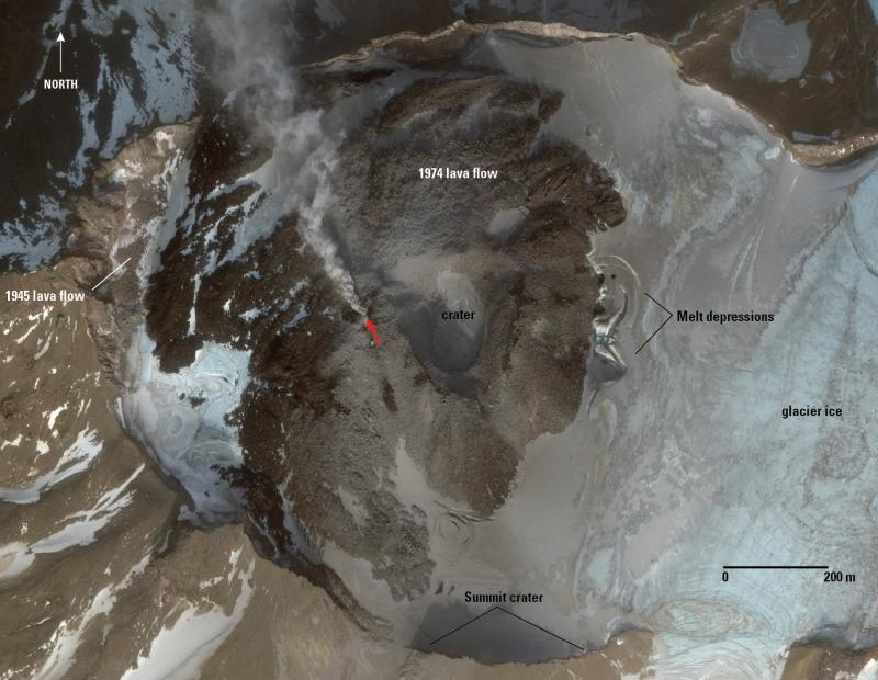 Worldview-3 satellite image of the summit area of Great Sitkin volcano, November 21, 2017. The area of steaming indicated by the red arrow is the likely source of the volcanic emissions noted and photographed by local observers on Adak, November 19, 2017. The melt depressions on the east side of the 1974 lava flow were evident in a September 14, 2017 satellite image but not present in an April 18, 2017 image indicating that they likely formed during the spring-summer 2017. (image: Chris Waythomas / AVO / USGS)