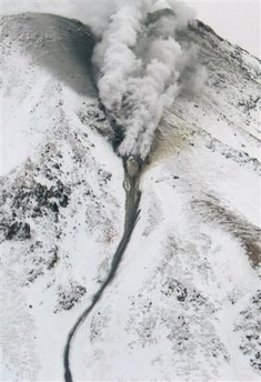 Smoke rising from Meakandake volcano and a mud flow travelling from the summit through a ravine. (AP Photo/Kushiro Local Metrological Observatory via Kyodo News)