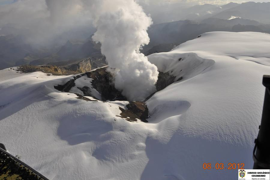 The snow-caped summit and steaming crater of Nevado del Ruiz volcano on 8 March