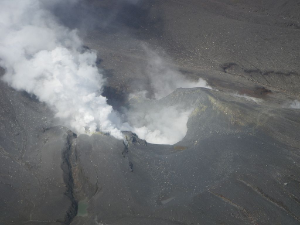 Picture of Upper Te Maari Crater looking south west. The main Upper Te Maari Crater is in the centre with the main gas discharge area to the left (east) at the head of the prominent fissure running to the base of the picture. (GeoNet)
